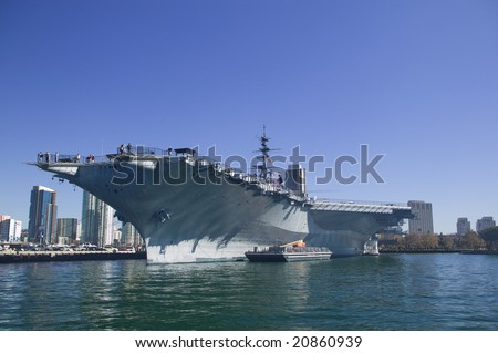 USS Midway CV-41 aircraft carrier docking in San Diego Bay - stock photo