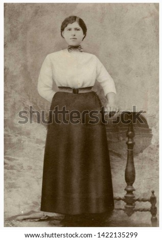 USSA, CIRCA 1930s. Woman posing. Retro black & white studio photography with sepia effect.