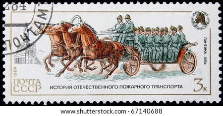USSR-CIRCA 1984: A post stamp printed in USSR show firemen , devoted history of fire transport, circa 1984.