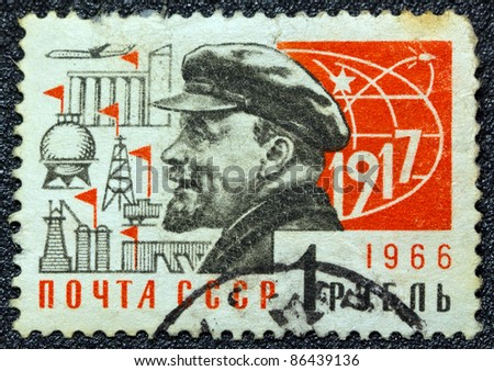 USSR - CIRCA 1966: A postage stamp printed in USSR shows Russian Marxist revolutionary and communist politician Vladimir Ilyich Lenin and the year of the October revolution (1917), circa 1966.
