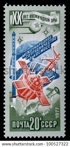 USSR - CIRCA 1977: a stamp printed by USSR shows orbital station and sputniks. 20 years of a space age. Series, circa 1977