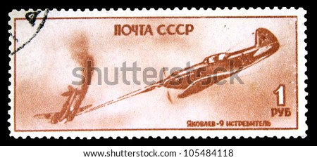 "USSR - CIRCA 1945: A Stamp printed in the USSR (Russia) shows aircraft with the inscription ""Ykovlev - 9"", Fighter"", series ""Victory of Allied Nations in Europe"", circa 1945"