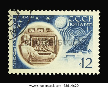 USSR - CIRCA 1971: A stamp printed in the USSR showing preparations of moon rover circa 1971 - stock photo