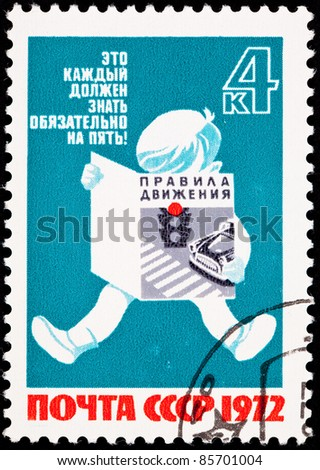 USSR - CIRCA 1972: A stamp printed in the USSR shows a young child reading traffic safety brochure, circa 1972.