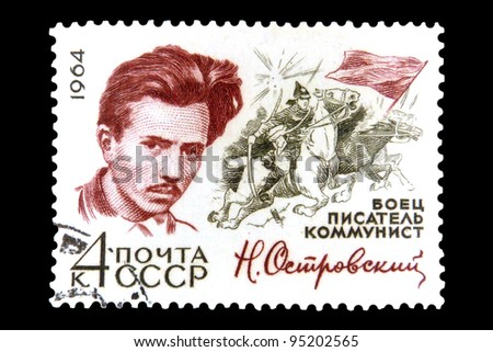 "USSR - CIRCA 1964: A stamp printed in USSR shows Ostrovsky portrait and battle scene with inscription ""Fighter, writer, communist"", from series ""60th Birth Anniversary of N. A. Ostrovsky"", circa 1964"