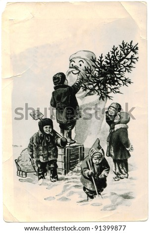 USSR - CIRCA 1958: Greeting Christmas Card printed in the USSR on photo paper, depicts children who molded snowman. North Ossetia, circa 1958.