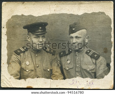 USSR - CIRCA 1945: Photo taken in the USSR, depicted two soldiers of the Red Army, circa 1945. The inscription on hands, the Russian name - Sergey.