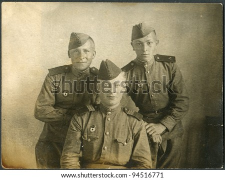 USSR - CIRCA 1944: Photo taken in the USSR, shows three soldiers of the Red Army, circa 1944
