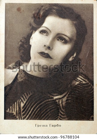 USSR - CIRCA 1928: Postcard printed in the USSR shows photo of Swedish film actress Greta Garbo, circa 1928. Text in Russian: Greta Garbo.