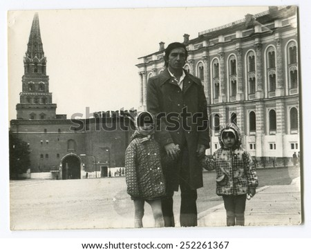 Ussr - CIRCA 1980s: An antique Black & White photo show father and two children