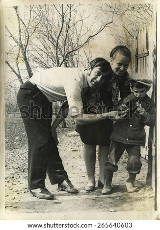 Ussr - CIRCA 1970s: An antique Black & White photo show parents with son