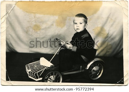 USSR - CIRCA 1960s: The little boy on the pedal car, circa 1960s