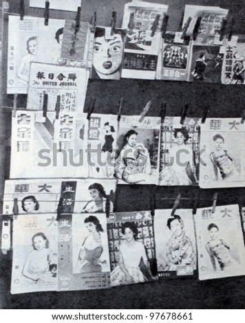 """USSR - CIRCA 1957: Soviet magazine """"Ogoniok"""" shows photo of newsstand storefront in Chinatown in New York made by U. Gukov, publishing house """"Pravda"""", issue 3, circa 1957 in Moscow, USSR"""