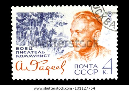 "USSR - CIRCA 1971: stamp printed in USSR (Russia) shows portrait of Aleksandr Fadeev with the inscription ""Fighter, writer, communist"", series ""70th Birth Anniversary of Aleksandr Fadeev"", circa 1971"