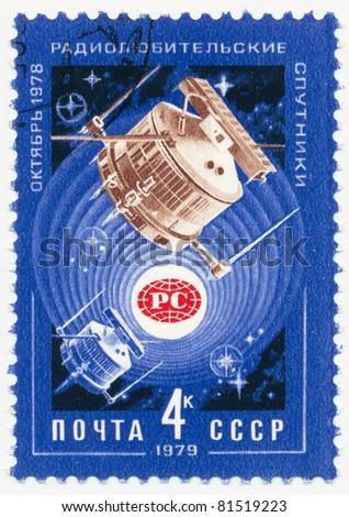 USSR - CIRCA 1979: stamp printed in USSR, shows Sputniks, Soviet Radio Hams Emblem,  circa 1979