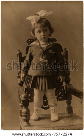 USSR - CIRCA 1930: The little girl in a sailor, Kharkov, Ukraine, June 15, 1930, the Russian text - Red light painting, Kharkov