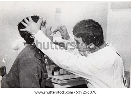 USSR, LENINGRAD - CIRCA 1969: Vintage photo of dentist at work in Leningrad, USSR