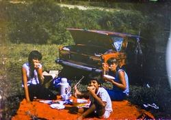 USSR, LENINGRAD - CIRCA 1983: Vintage photo of family car trip vacation picnic scene in USSR