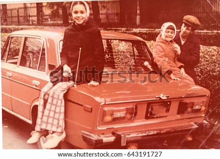 USSR, LENINGRAD - CIRCA 1980: Vintage photo of family soviet car trip in Leningrad, USSR