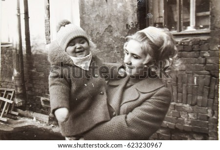 USSR, LENINGRAD - CIRCA 1970: Vintage photo of happy young mom with toddler girl daughter in Leningrad, USSR #623230967