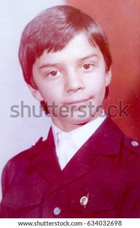 USSR, LENINGRAD - CIRCA 1985: Vintage photo of little school boy smiling portrait in Leningrad, USSR