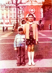 USSR, LENINGRAD - CIRCA 1978: Vintage photo of little sister and little brother on Palace Square in Leningrad, USSR