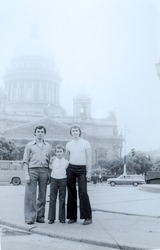 USSR, LENINGRAD - CIRCA 1976: Vintage photo of three brothers at Kazan Cathedral background in Leningrad, USSR