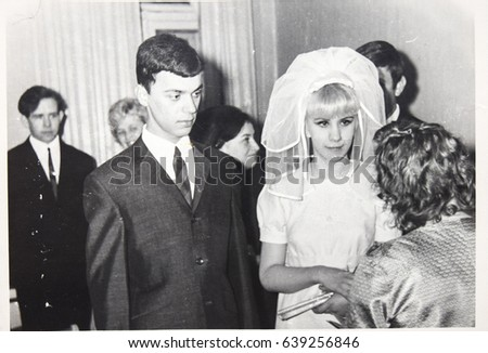 USSR, LENINGRAD - CIRCA 1969: Vintage photo of wedding couple. Just married couple. Soviet bride and groom wedding in Leningrad, USSR