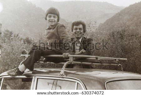 USSR, WESTERN UKRAINE, CARPATHIAN MOUNTAINS - CIRCA 1982: Vintage photo of father with little son smiling. Western Ukraine, USSR