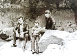 USSR, WESTERN UKRAINE, CARPATHIAN MOUNTAINS - CIRCA 1982: Vintage photo of mom, dad and son on mountain river rocks in Western Ukraine, USSR. Soviet family Tsyukevitch
