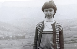 USSR, WESTERN UKRAINE, CARPATHIAN MOUNTAINS - CIRCA 1982: Vintage photo of young girl Inna Tsyukevitch on mountain landscape in Western Ukraine, USSR