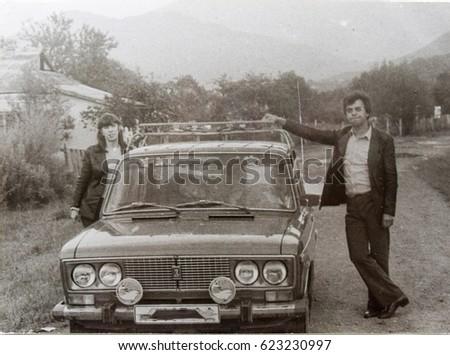 USSR, WESTERN UKRAINE, DOLISHNEE VILLAGE- CIRCA 1982: Vintage photo of family own car vacation scenein Western Ukraine, USSR