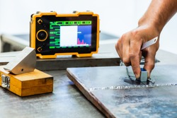 UT, Ultrasonic testing to detect imperfection or defect in welding of steel structure. NDT Inspection.