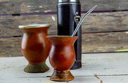 Utensils for drinking mate and mate. Chimarrão, or mate, is a characteristic drink of the Southern Cone culture, inherited by the indigenous cultures of Caingangue, Guarani, Aymara and Quechua.