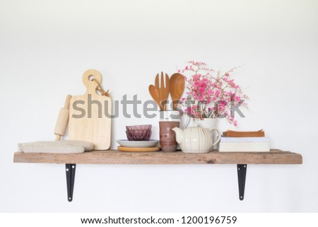 utensils on wooden shelf on white wall background. Decoration home interior design in kitchen room. #1200196759
