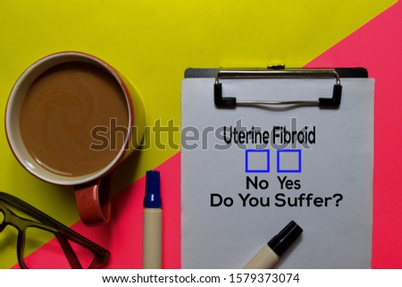 Uterine Fibroid, Do You Suffer? Yes or No. On office desk background