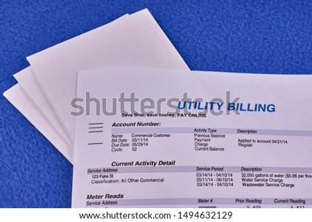 Utility billing sheet nad envelopes on a blue velvet background