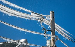 Utility pole and wires covered in ice