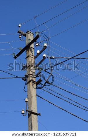 Utility pole. High voltage powerline. #1235639911