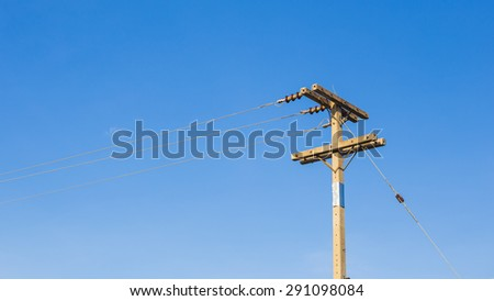 Utility pole supporting wires for electrical power distribution, coaxial cable for Cable TV, and telephone cable.