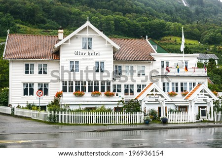 UTNE, NORWAY - AUGUST 16: Old white wooden hotel in Utne, Norway, on August 10, 2013. Utne Hotel is one of Norway�s oldest hotels in continuous operation in the same building