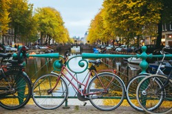 Utrecht. Canal in the center of the city at sunset. Bicycles standing on the bridge with an amazing Amsterdam view.