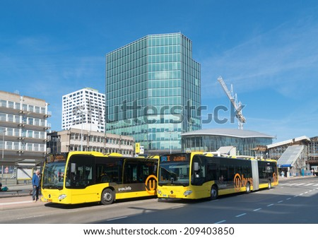 UTRECHT, NETHERLANDS - MAY 17, 2014: Exterior of the utrecht central station. It is the main hub of the railway lines in the Netherlands and is the area\'s largest railway station in the Netherlands