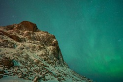 Uttakleivbeach, near Leknes, Lofoten, Norway, 03 07 2019: making photos beach at Uttakleiv of northern light and starry stars at nightscape landscape