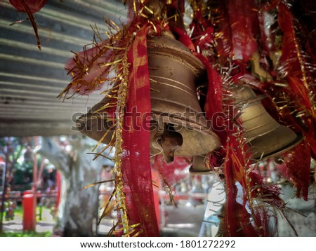 uttarakhand,india-2 june 2020:bells.View of bells at temple,chitai temple.two bells tied with red religious cloth.temple bells wallpaper.religious bell.metal bells.
