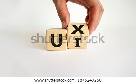 UX design or UI design. Male hand turns cube and changes word 'UX - user experience' to 'UI - user interface'. Beautiful white background. Business and UI or UI concept. Copy space. Photo stock ©