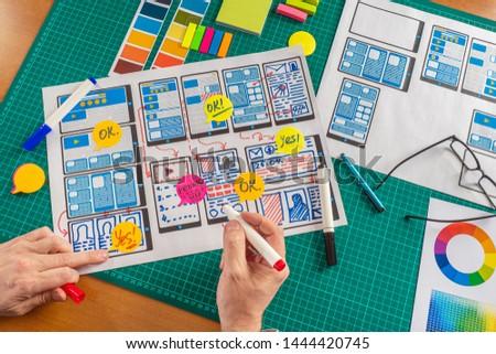 Ux ui design. Graphic designer draws a rough sketch projected mobile application. Web prototyping. Web infographics. Development of mobile application model. #1444420745