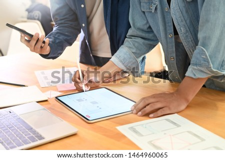 UX UI layout a Team designer working with digital device and sketch template on paper. #1464960065