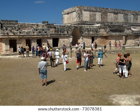UXMAL, MEXICO-CIRCA MAR 2011: Tourists view the ruins circa March 2011 in Uxmal, Mexico.The city was abandoned over 600 years ago, but now competes with Chichen Itza, one of the 7 wonders of the world