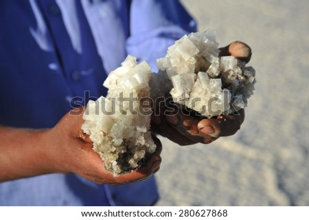 UYUNI LAKE, BOLIVIA - SEPTEMBER 9, 2010: Bolivians mined salt crystals on the Uyuni salt flats, dried up salt lake in Altiplano. The largest salt flat in the world.